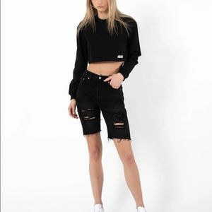 Levis 501 slouchy distressed black shorts